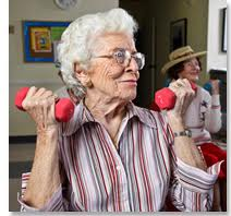 older-woman-lifting-small-barbells