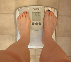 weight-scale-with-woman-on-itweight-scale-with-woman-on-it