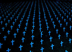graveyard-filled-with-crosses-in-blue-cancer-heart-disease