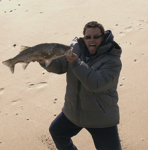 guy-holding-big-fish-and saying-whzaaaaaup!
