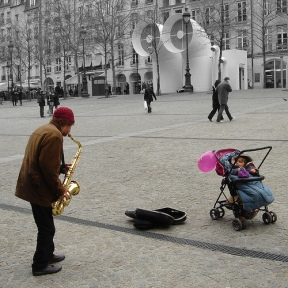 saxophone-player-on-street-only-watcher-is-a-baby