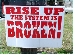 sign-with-rise-up-the-system-is-broken-FDA