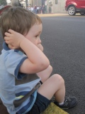child-covering-his-ears-to-protect-from-useless-government-noise