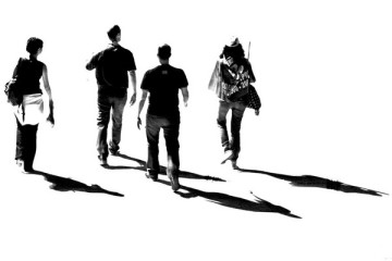 walking-together-four-friends-with-their-shadows-in-black-and-white-exercise-social