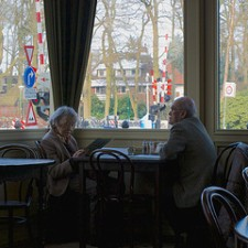 elderly-couple-eating-at-restaurant