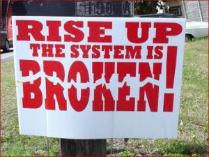 sign-saying-rise-up-the-system-is-broken