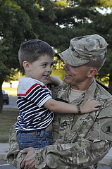 troop-being-welcomed-home-joyously-by-his son