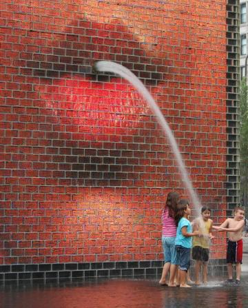sprinkler-fountain-for-kids-hot-day-coming-from what-appears-to-be a mouth