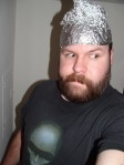 man-wearing-aluminum-foil-thinking-cap