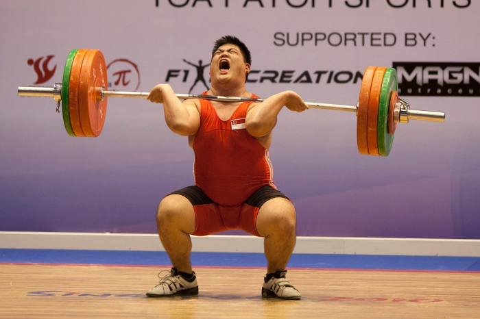 weightlifter-burning-calories-from-carbohydrates-broken-down-to-glucose-for-lifting-energy