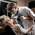 RENOVATING-YOUR-MIND-does-some-dampening-on-dental-pain-dentist-with-patient
