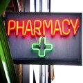 neon-pharmacy-sign-with-green-cross