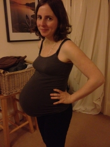 smiling-pregnant-woman-showing-fetal-bump-requires-more-nutrients-for-fetus