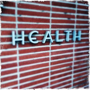 health-sign-on-wall-brick-background
