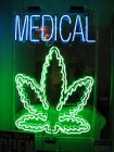 RENOVATING-YOUR-MIND-medical-marijuana-treatment-diseases-fluorescent-sign-saying-medical-picture-marijuana-leaf-green1.jpg